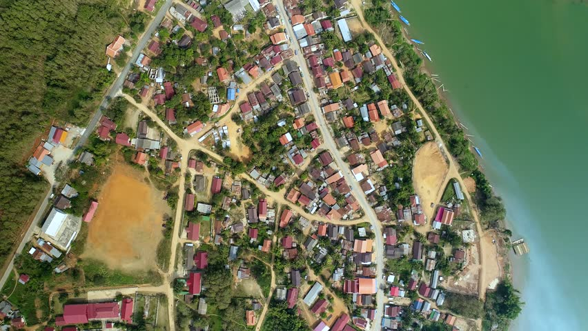 4k Video shot aerial view by drone. Nong Khiaw village, river, green hills, Luang Pranbang, Laos