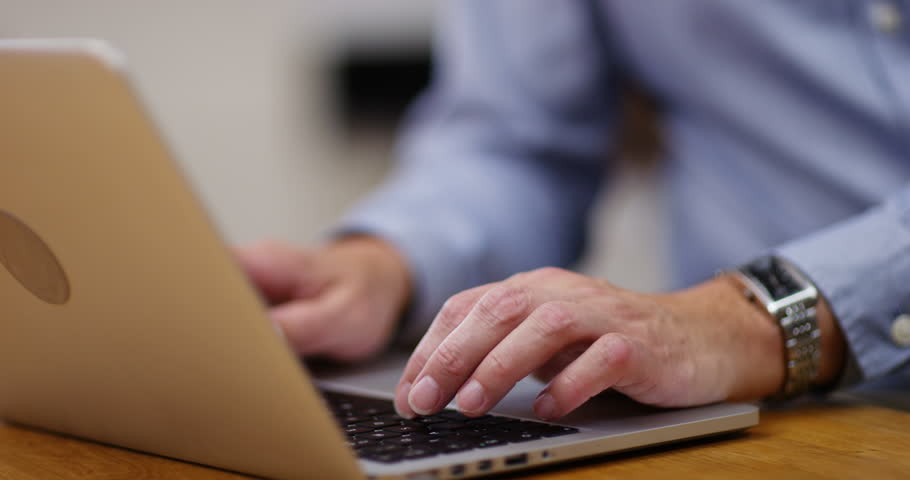 4K Close up on hands & face of mature businessman doing data entry on laptop | Shutterstock HD Video #1008323620