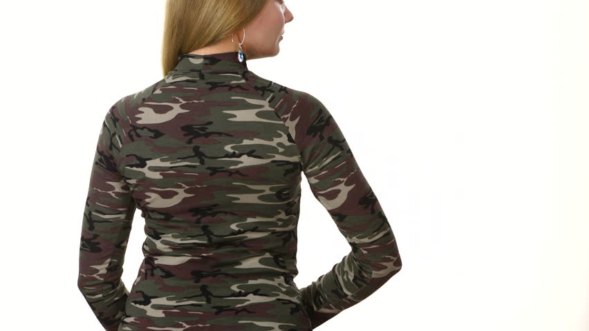 Woman wearing fashionable green blouse stylish camo pattern top, model presenting clothing, back view on white. Fashion concept.