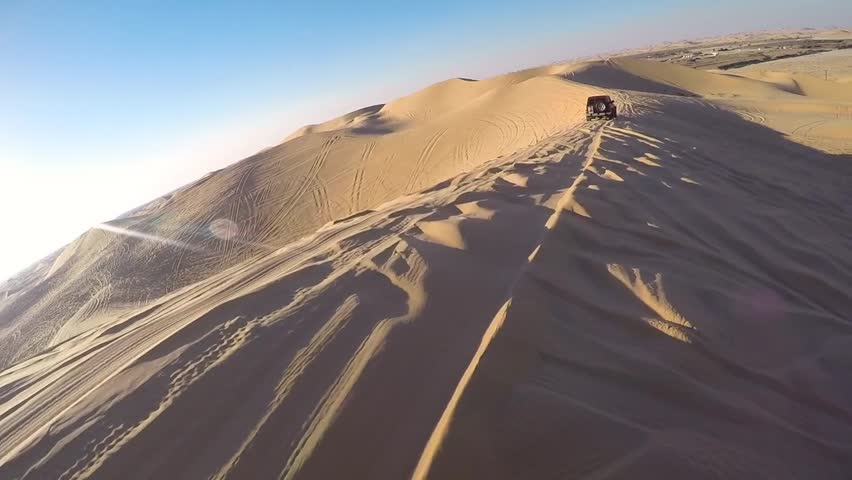 Driving with a four wheel drive through the desert of the United Arab Emirates near Abu Dhabi.