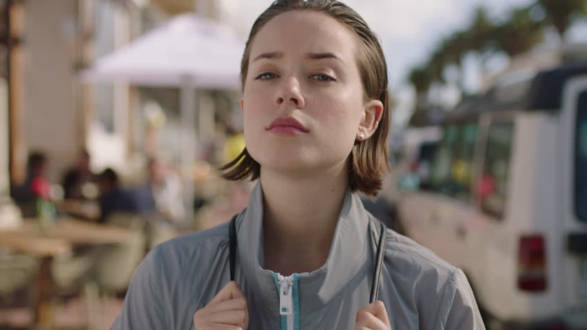 Portrait of attractive woman waiting impatient on beachfront looking annoyed | Shutterstock HD Video #1008368290