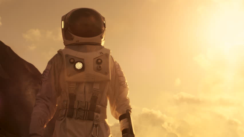 Middle Shot of the Astronaut Wearing Space Suit Exploring Mars/ Red Planet. First Manned Mission To Mars, Technological Advance Brings Space Exploration, Colonization. 4K UHD.