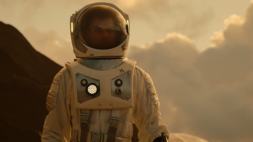 Medium Shot of the Astronaut Wearing Space Suit Walking and Exploring Mars/ Red Planet. Space Exploration, Discovery, Colonization Concept.  | Shutterstock HD Video #1008373510