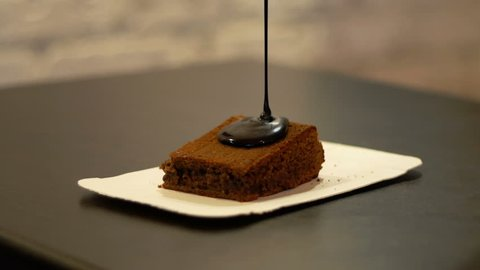 Making Chocolate Brownie Cake. Pouring Melting Chocolate