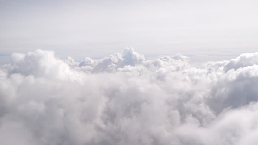 Aerial shot above the clouds in 4K | Shutterstock HD Video #1008413080