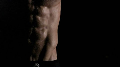 Six packs fit body background. In black with shadow cast. Copy space to the right.