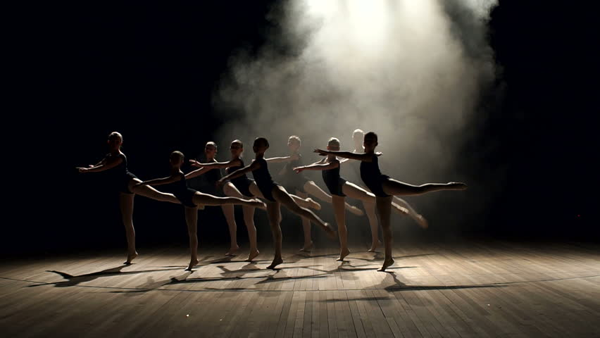 Young teen girls perform ballet on stage in smoke on black background. A choreographed dance of a group of graceful pretty young ballerinas practicing on stage in a classical ballet school. | Shutterstock HD Video #1008452200