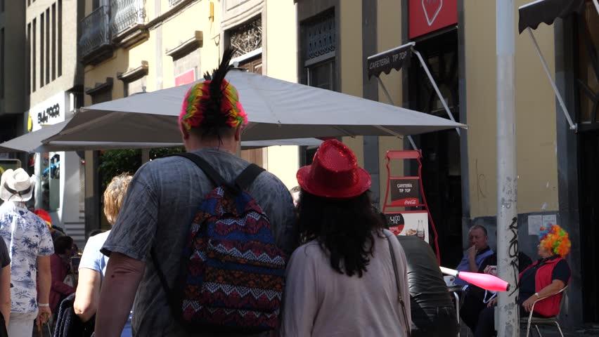 SANTA CRUZ DE TENERIFE - FEB 13, 2018: Street artist young guy juggle skittles entertain people in public place geathering applauses