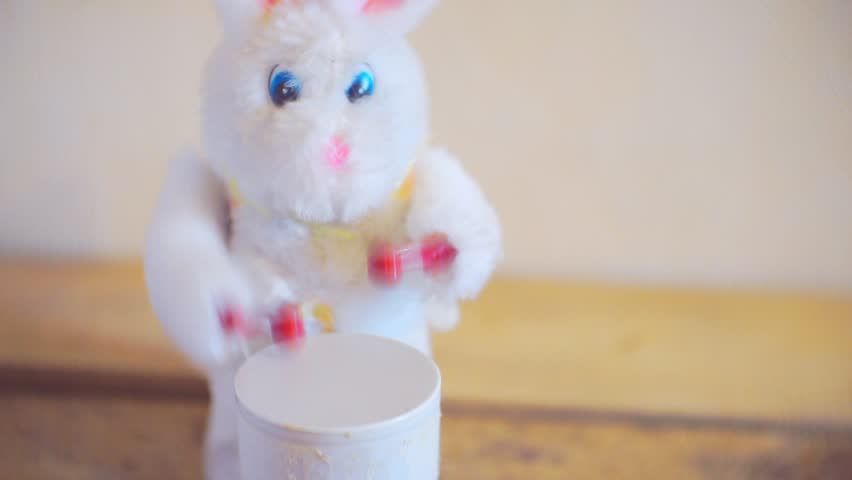 Furry toy rabbit pounding in a drum. | Shutterstock HD Video #1008461770