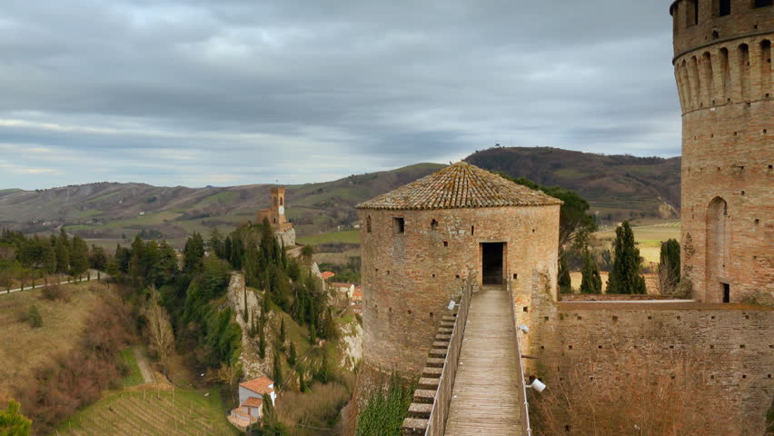 view of castle and clock tower in Italian hilly countryside