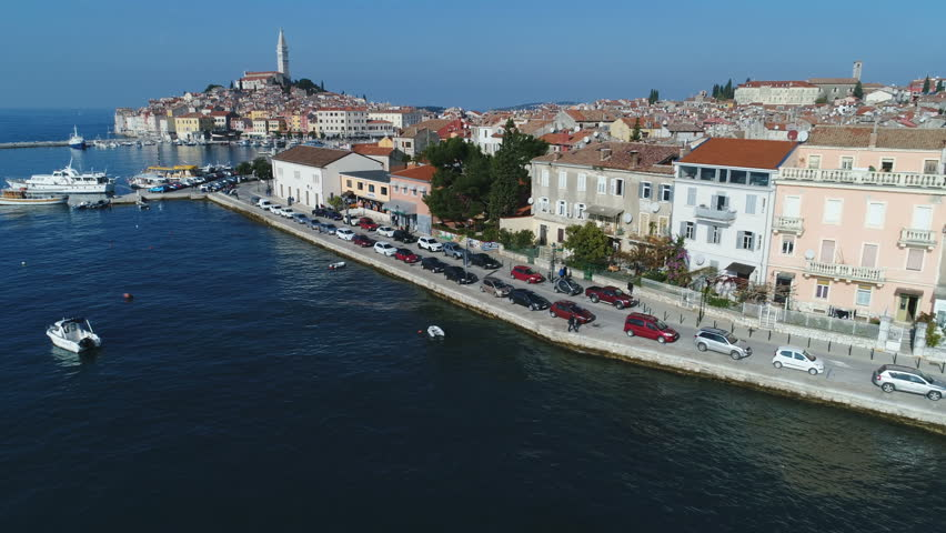 ROVINJ, CROATIA - NOVEMBER 2017: Low angle drone flight to Rovinj port and historic town, located on Istria peninsula, a popular holiday destination in Croatia   Shutterstock HD Video #1008517870