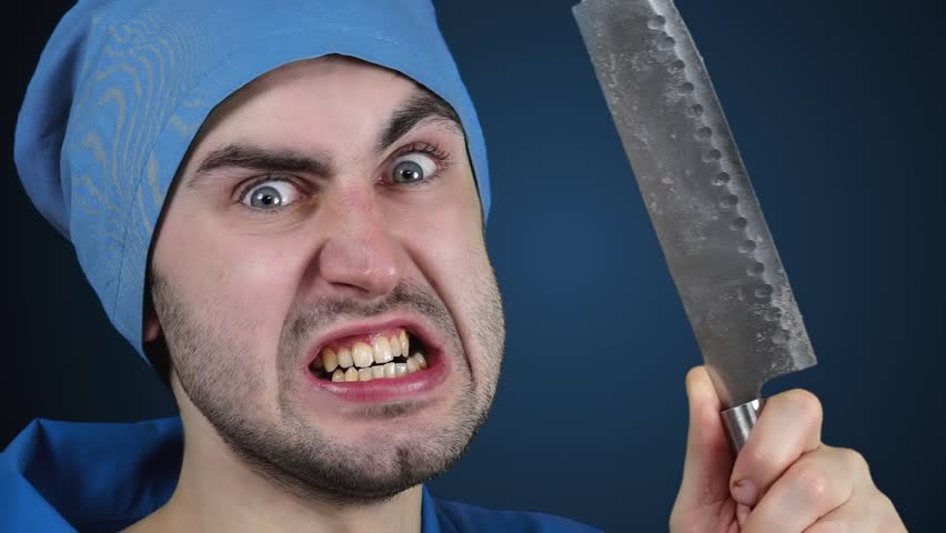 Angry crazy bearded doctor with a butcher knife in slow motion