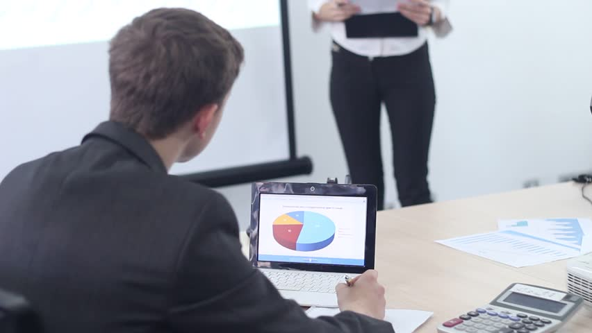Business woman working with presentation in modern office. Conference of researchers on advertising and business promotion. The company selling the product and the plan with the drawings. | Shutterstock HD Video #1008568900