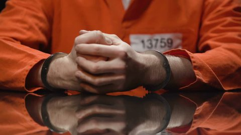 Inmate holds his head in desperate, feels regret about committing crime, closeup
