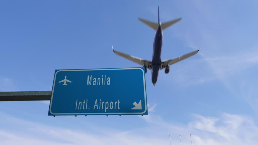 manila airport sign airplane passing overhead