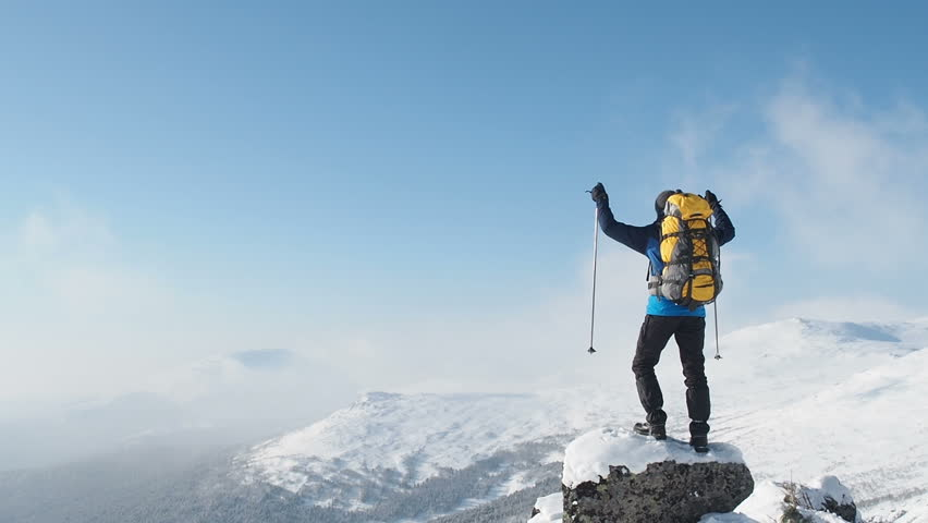 Young Hiker Man Standing On Top Of The Mountain. Mountain Alps Mountaineering Snow Climbers Travel. Hiker Man Raising Hands On Mountain Top Winner Concept. Hike Winter Mountaineer Hiking Trekking.