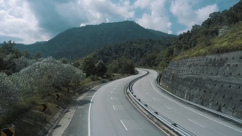 An aerial footage of empty road in the tropical forest somewhere in Malaysia.