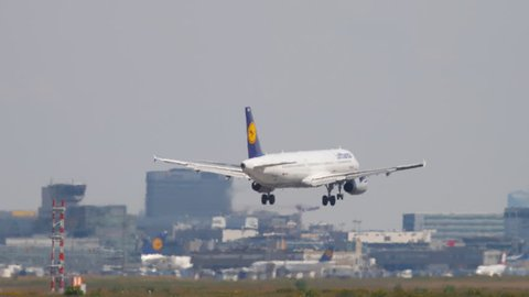 FRANKFURT AM MAIN, GERMANY - JULY 18, 2017: Lufthansa Airbus A321 D-AIDM approaching and landing on runway 7R. Fraport, Frankfurt, Germany