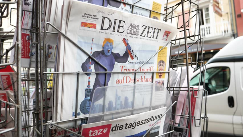 PARIS, FRANCE - CIRCA 2018: Press kiosk stand with Die Zeit German newspaper with caricature of Donald Trump and text Trump Attacks Germany