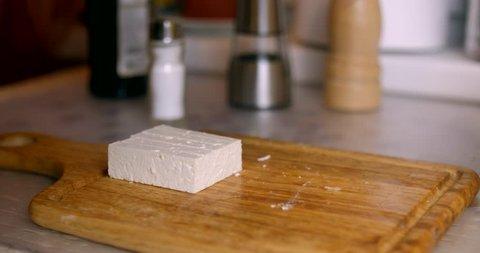 Feta cheese slicing closeup