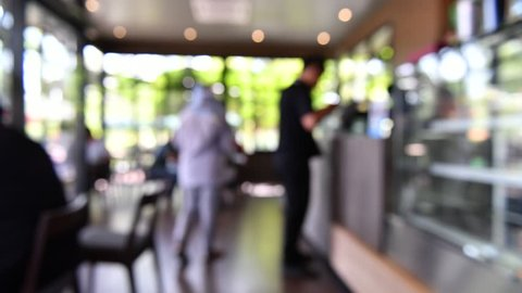 Blur image or defocus of customer in coffee shop, time lapse movie clip