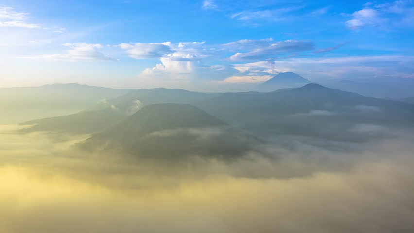 Indonesia. The island of Java. Dawn overlooking the active volcanoes of Bromo and Semeru. Time lapse