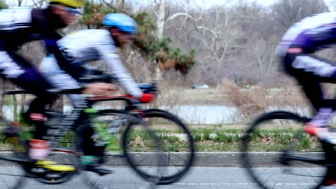 Road cycling race on city streets - slow motion