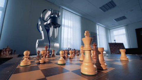 Artificial intelligence, robotic chess player play chess with a human.
