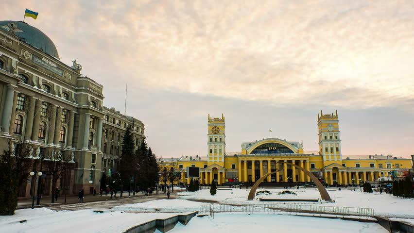Kharkiv, Ukraine. Railway station in Kharkiv, Ukraine, at sundown on a snowy cloudy day. People walking by, time-lapse