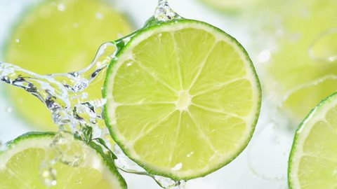 Water splash on sliced lime. Shot with high speed camera, phantom flex 4K. Slow Motion.