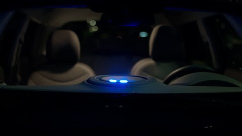 An electric vehicle (EV) with its charging indicator lights flashing on the dashboard.