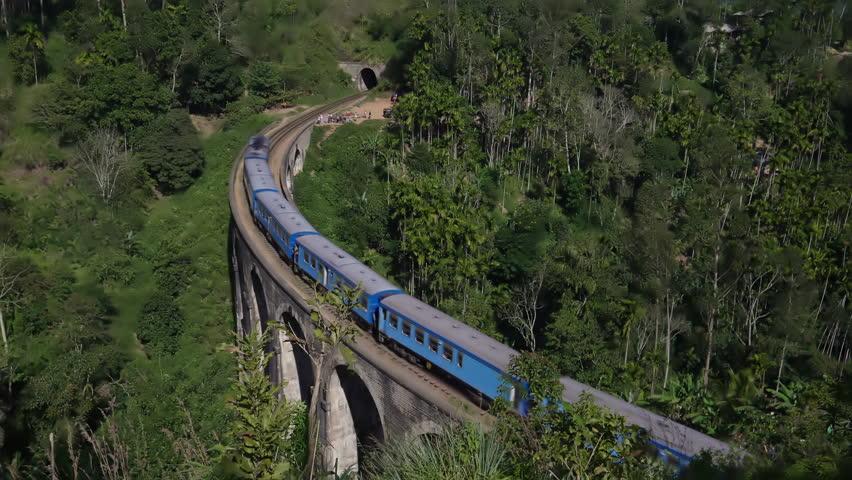 Train goes along the Nine Arches Bridge in Sri Lanka.