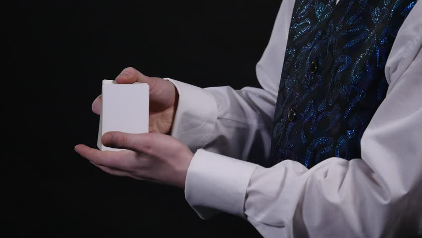 Magic, card tricks, gambling, casino, poker concept - man showing trick with playing cards | Shutterstock HD Video #1008822320