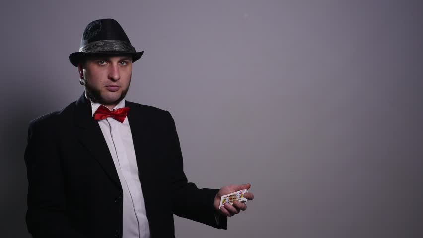 Magic, card tricks, gambling, casino, poker concept - man showing trick with playing cards | Shutterstock HD Video #1008822350