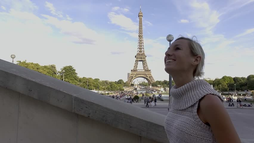 4K video of a young woman wandering in the streets of Paris near the Eiffel Tower, contemplating the view and enjoying travel. People cities traveling concept | Shutterstock HD Video #1008840470