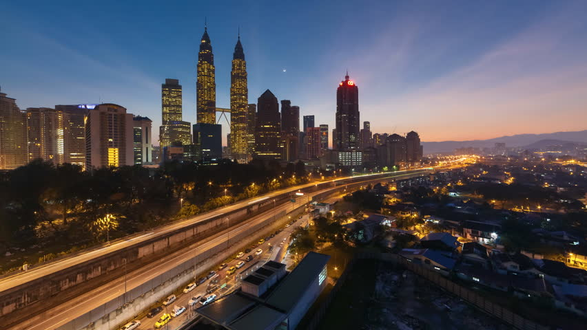 Kuala Lumpur city Central Business District skyline sunrise night to day time lapse. 4K
