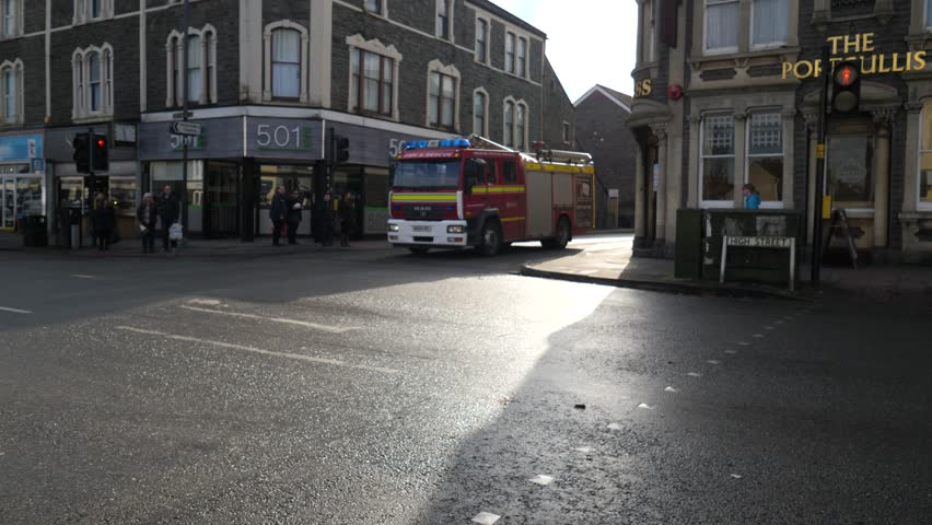 Bristol, England / United Kingdom (UK) - 02 10 2018: Fire truck responding on an emergency turns in a corner in Bristol
