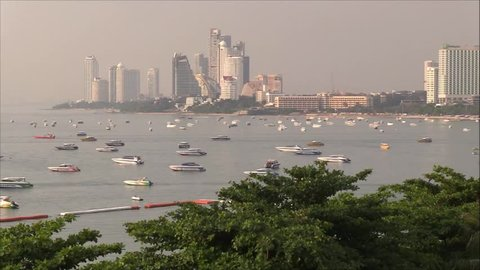 Pattaya city, Pattaya bay timelapse video.Sailing ships, sailboats at Pattaya city. Pattaya city beach and Gulf of Siam in Thailand, Asia. Floating boats and ships and skyscrapers.