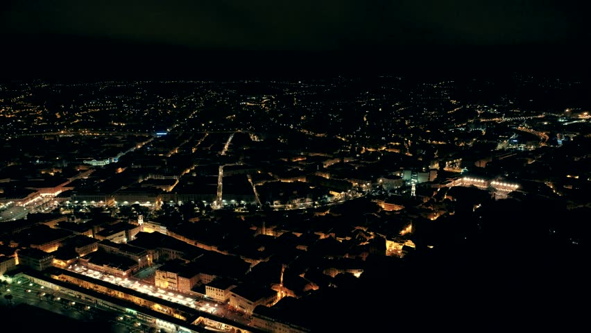 Night aerial panorama of illuminated Nice town in France. Flight over promenade.