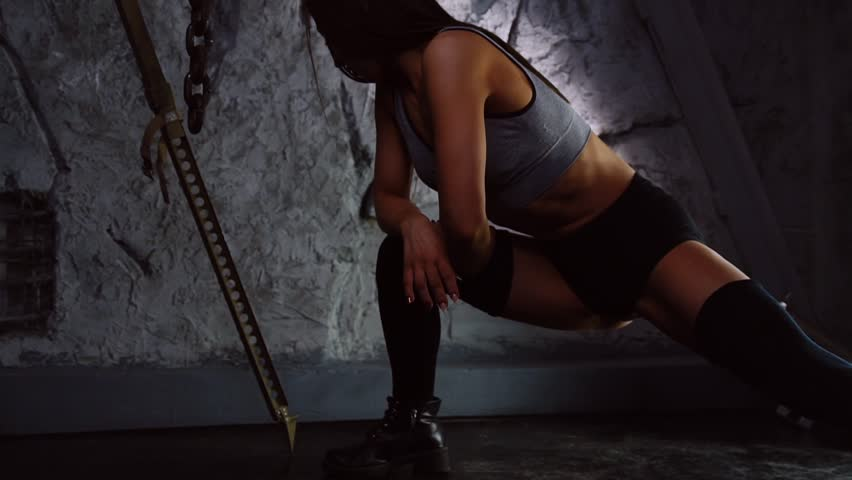 Brutal sports girl does the squats on one leg with the rapids. Leg and thigh workout close-up | Shutterstock HD Video #1008906320