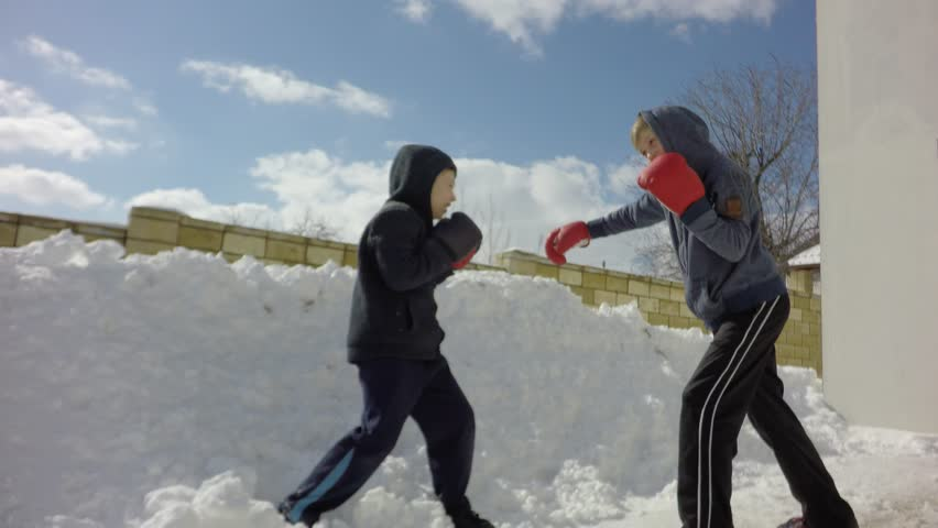 Sports children, training in boxing. Special boxing exercises in the winter. | Shutterstock HD Video #1008909380