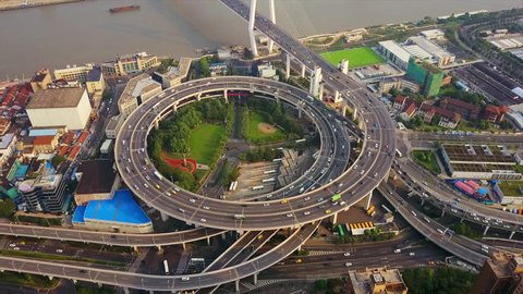 SHANGHAI, CHINA - SEPTEMBER 8, 2017: sunset time shanghai city famous traffic round road junction aerial panorama 4k circa september 8 2017 shanghai, china.