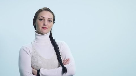 The girl looks skeptical, haughty, suspects, on a white background
