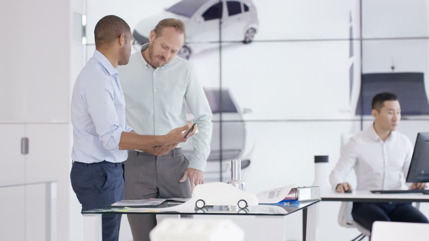 Automotive car CAD designers and engineers working on electric autonomous vehicle   Shutterstock HD Video #1008977960