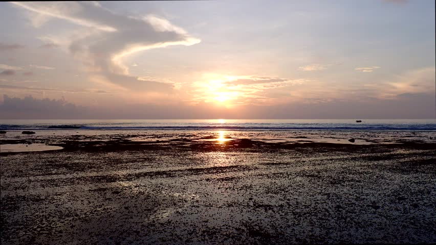 Littoral zone at low tide at sunset in the island Fuvahmulah, Indian Ocean, Maldives