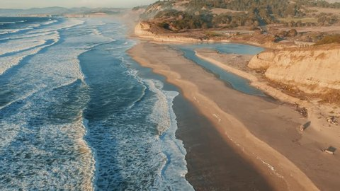 Aerial view of California Coastline along the Big Sur. USA homes line the cliffs overlooking the blue ocean.