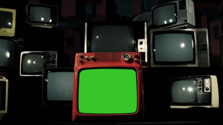 """Vintage Red TV with Green Screen over Many Retro TVs from the 80s and 90s. Dolly Out. Iron Tone. You can Replace Green Screen with the Footage or Picture you Want with """"Keying"""" effect in AE.    Shutterstock HD Video #1009079120"""