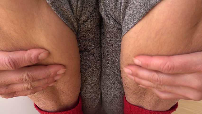 4K Woman strokes her hairy ankles  | Shutterstock HD Video #1009079570