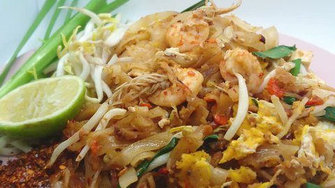 Fried Rice Sticks noodle with fresh prawns dry shrimp, Pad Thai on the pink plate