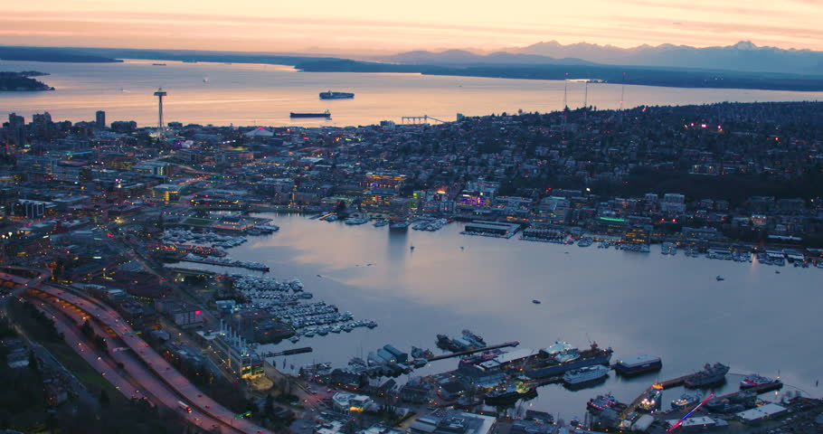 Amazing Sunset Helicopter Aerial Shot Seattle Washington USA Lake Union to Puget Sound Cinematic Panoramic View Skyline Architecture Coast Waterfront San Juan Islands Olympic Mountains View Futuristic